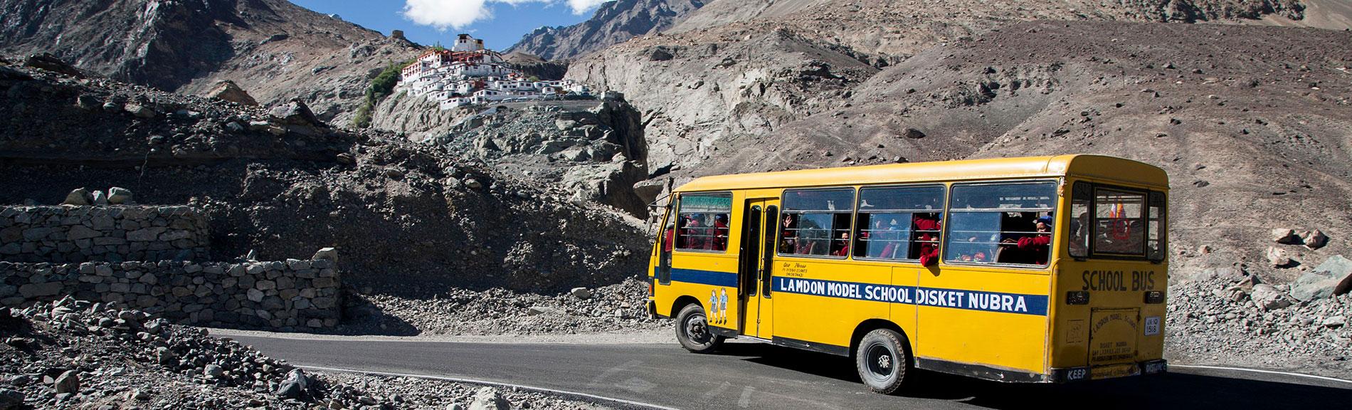 slide-lamdon-model-school-nubra-bus